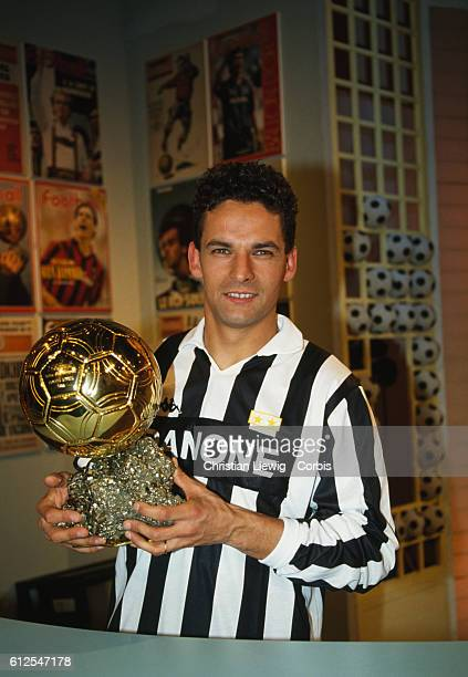 Italian soccer player Roberto Baggio displays the European 'Ballon d'Or' he was awarded in 1993