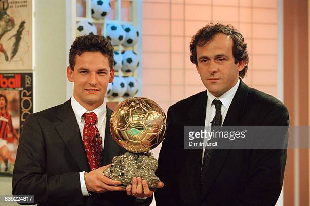 Italian soccer player Roberto Baggio receiving the European 'Ballon d'Or' for the year 1993 from former French player Michel Platini