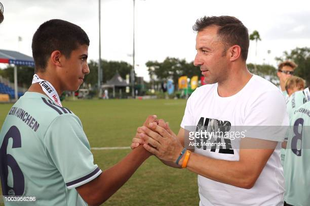 Italian soccer star Alessandro Del Piero gives Dominik Ceko of FC Bayern Munich a gold medal in his victory over Chelsea FC during the International...