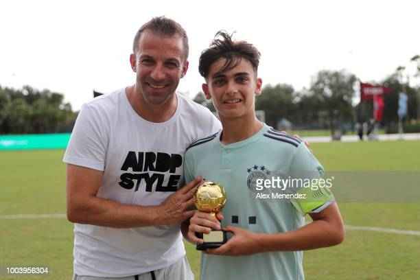 Italian soccer star Alessandro Del Piero gives Giancarlo Lore of FC Bayern Munich a trophy in his victory over Chelsea FC during the International...