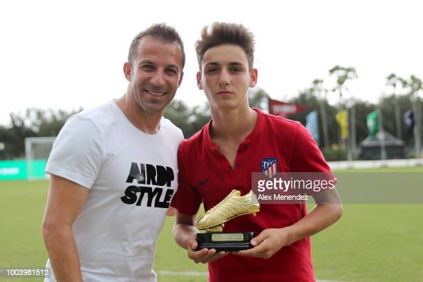 Italian soccer star Alessandro Del Piero presents Marcos Denia Diaz of Atletico De Madrid the Golden Boot award during the International Champions...