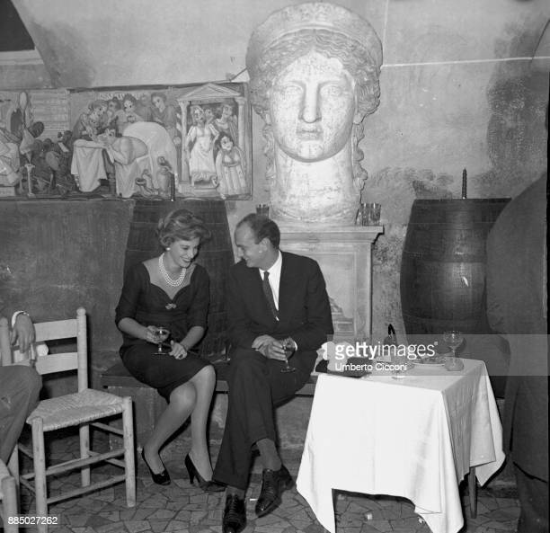 Italian socialite Luciana Pignatelli and Nicola Caracciolo talking at the restaurant 'Rugantino' during a dinner party Rome 1958