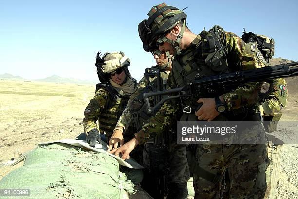 Italian soldier of the Folgore Parachute Brigade and of Brigata Bersaglieri Garibaldi check the maps and patrol the area near the checkpoint on the...