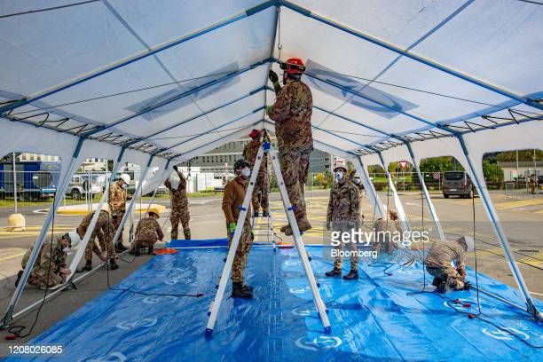 Italian soldiers assist with the construction of a field hospital to be run by nongovernmental organisation Samaritan's Purse outside of Cremona...