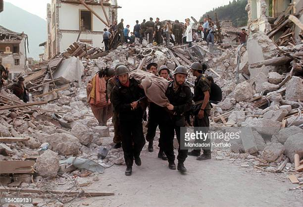 Italian soldiers carrying a stretcher on a person injured under the rubble of the earthquake FriuliVenezia Giulia May 1976