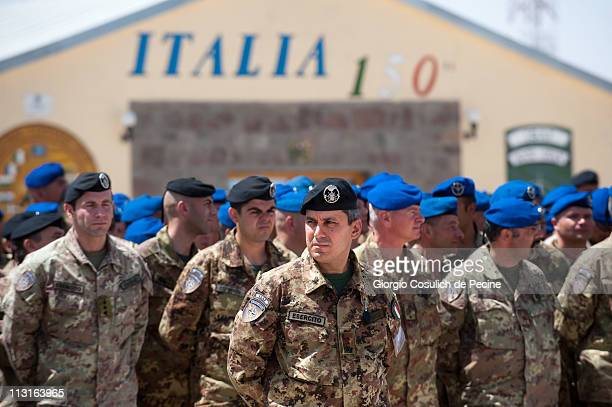 Italian soldiers gather at the ISAF NATO base during the celebration of Easter Monday on April 25 2011 in Herat Afghanistan The international...