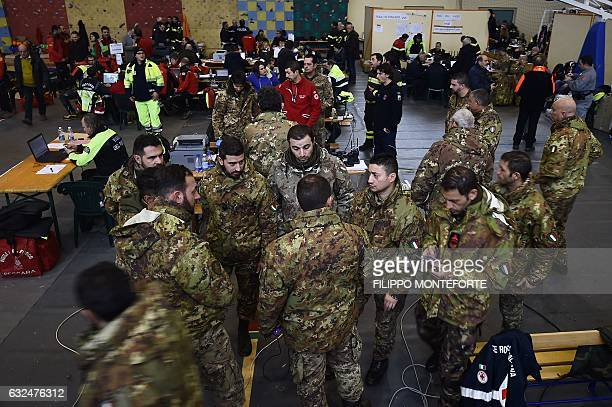 Italian soldiers gather at the rescue operations center in Penne, some 20 km from the site of an avalanche that engulfed the Hotel Rigopiano in heavy...