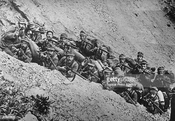 Italian soldiers in a trench on a mountain side ready for action