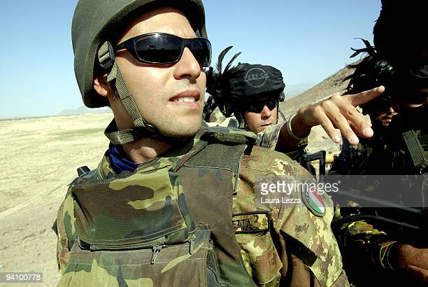 Italian soldiers of the Folgore Parachute Brigade and Brigata Bersaglieri Garibaldi patrolling the area off the Highway 517 during a daily operation...