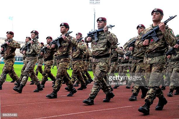 Italian soldiers of the Folgore Parachute Brigade march during a ceremony to mark the 67th anniversary of The Battle of El Alamein at Stadio Armando...