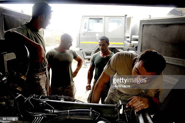Italian soldiers of the Folgore Parachute Brigade specialized mechanical repair armored vehicles inside the Fob base on September 16 2009 in Farah...