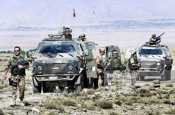 Italian soldiers of the NATOled International Security Assistance Force patrol in a village northeast of Kabul 08 June 2004 The multinational ISAF...