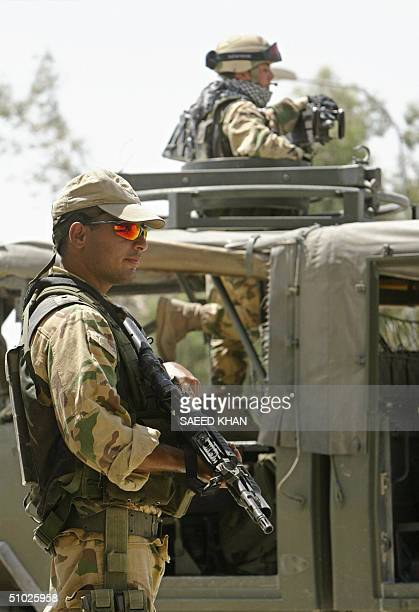 Italian soldiers patrol the town of Nassiriyah, 375 kms southeast Baghdad 05 July 2004. Italy has nearly 3,000 men deployed in the region of...