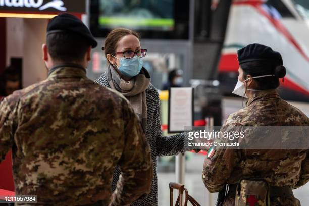 Italian soldiers speak to a passenger at Milano Centrale train station on March 10 2020 in Milan Italy The Italian Government has taken the...