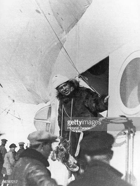 Italian solider and explorer Umberto Nobile leans out the doorway of one of the gondola's of his airship 'Italia' prior to his departure on his...
