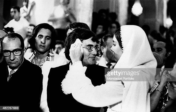 Italian songwriter Al Bano born Albano Carrisi and the American actress Romina Power in the church during the celebration of their marriage...