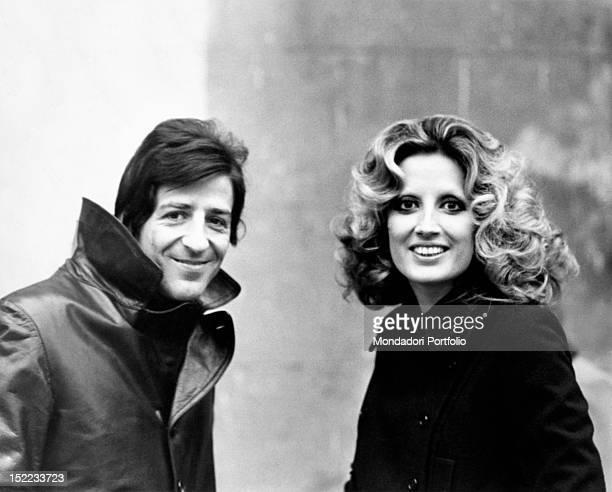 Italian songwriter and singer Giorgio Gaber smiling beside Italianborn Swiss singer Mina Milan 1970s