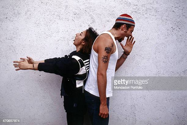 Italian songwriters Gianna Nannini and Jovanotti pose together before a wall the two artists have recently collaborated to the song Radio Baccano in...