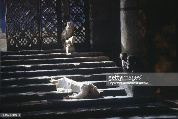 Italian soprano Katia Ricciarelli as Desdemona lying dead on a staircase beside Spanish tenor Placido Domingo who killed her in the film Otello. 1986