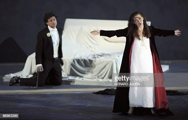 Italian soprano Patrizia Ciofi acting as Violetta Ciofi and Italian tenor Vittorio Grigolo as Alfredo Germont perform on July 9 in Giuseppe Verdi's...