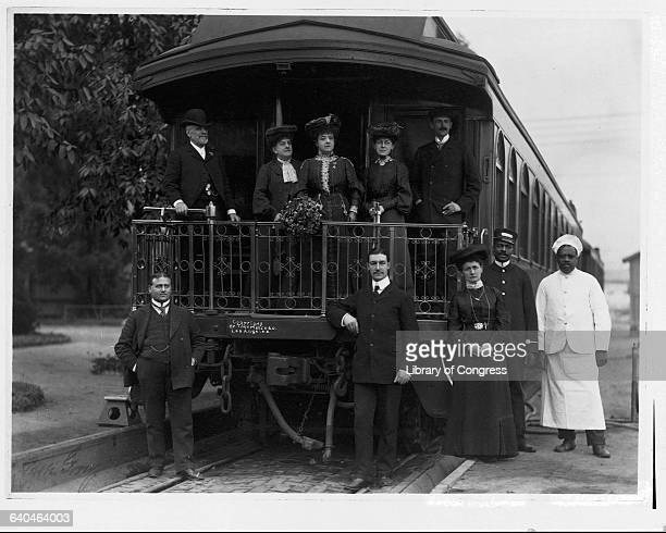 Italian soprano Patti Adelina with other opera singers and service crew at back of pullman car