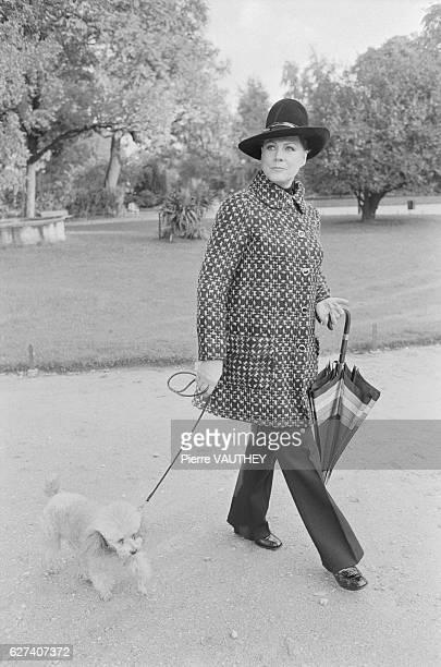 Italian soprano Renata Tebaldi walks her dog in a Paris park