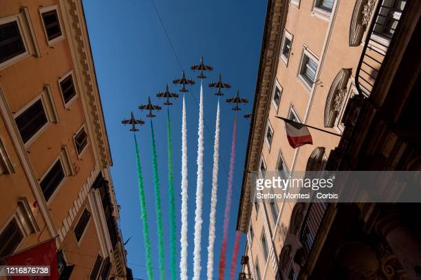 Italian Special Air Force aerobatic unit Frecce Tricolori spreads smoke with the colors of the Italian flag over the city of Rome as part of the...