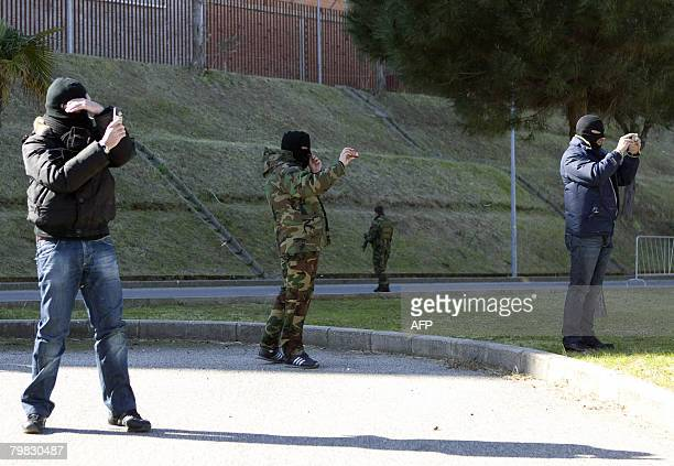 Italian special force police shoot pictures of Pasquale Condello following his arrest late February 18 2008 in Italy's soutern city of Reggio...
