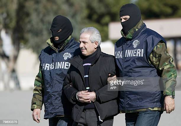Italian special police force escort Pasquale Condello following his arrest on February 18 in Reggio Calabria Condello one of Italy's most wanted...