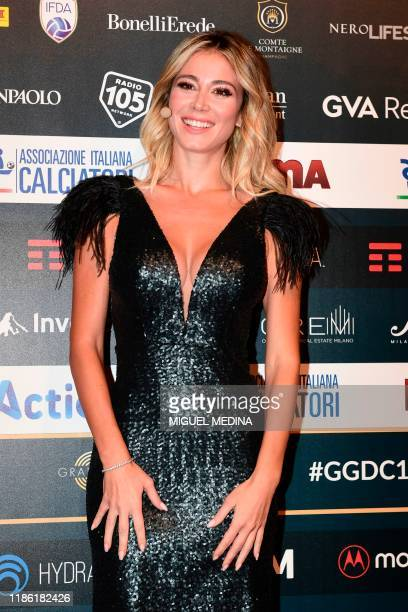 Italian Sports journalist and TV host Diletta Leotta poses on the red carpet as she arrives to attend the 'Gran Gala del Calcio' awards ceremony...