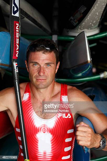 Italian sprint canoer Antonio Rossi before a training session poses on the canoes hangar near the lake of Pusiano Province of Lecco Italy 2008