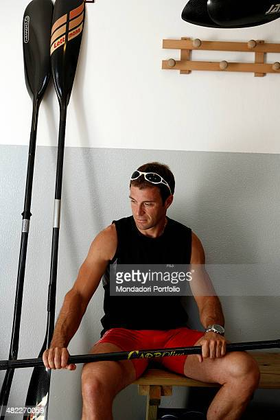 Italian sprint canoer Antonio Rossi in the canoes hangar holds a paddle and gets ready for a training session on the lake of Pusiano Province of...