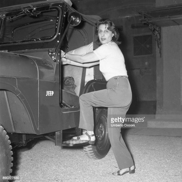 Italian stage and film actress Anna Magnani gets on the jeep at 'Palazzo Altieri' Rome 1957