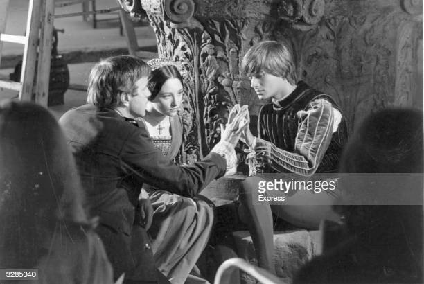 Italian stage and film director Franco Zeffirelli with Olivia Hussey and Leonard Whiting during the filming of 'Romeo and Juliet'