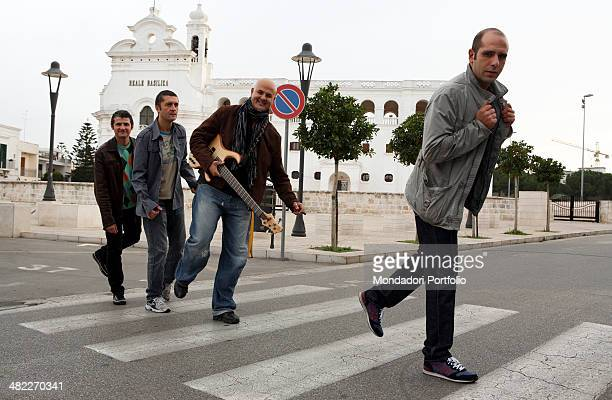Italian standup comedian impersonator and musician Luca Medici best known with his stage name of Checco Zalone poses crossing the street on the...