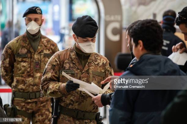 Italian State Police officers and Italian soldiers process passengers leaving from Milano Centrale train station on March 10 2020 in Milan Italy The...
