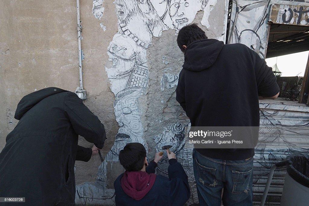 Street Artist Blu Erases His Murals In Bologna : News Photo
