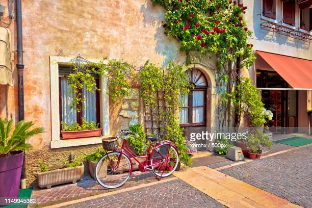 italian street old architecture in lazise - acorn street boston stock pictures, royalty-free photos & images