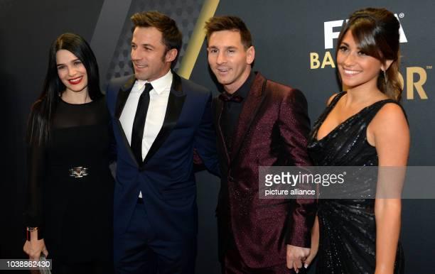 Italian striker Alessandro Del Piero his wife Sonia Argentinian striker Lionel Messi and his girlfriend Antonella Roccuzzo arrive before of the FIFA...