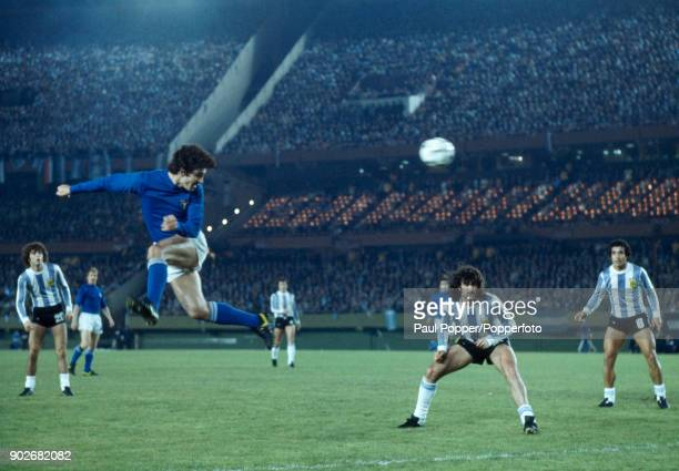 Italian striker Paolo Rossi is unchallenged as he heads the ball towards the Argentina goal during the FIFA World Cup match between Argentina and...