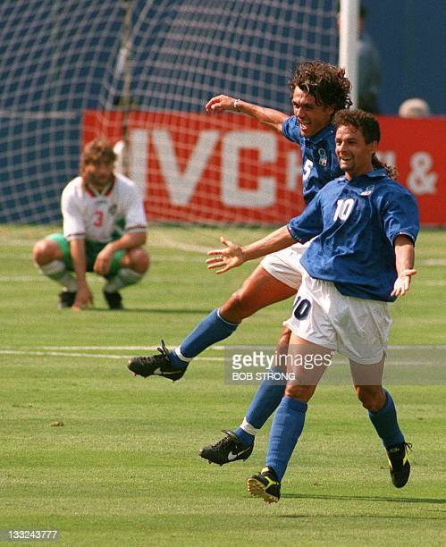 Italian striker Roberto Baggio and captain Paolo Maldini celebrate after Baggio scored his team's first goal against Bulgaria during their World Cup...