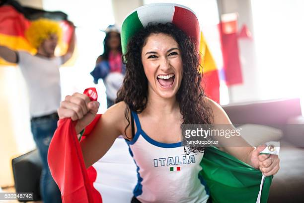 italian supporter woman at home looking the tv - fan enthusiast stock pictures, royalty-free photos & images