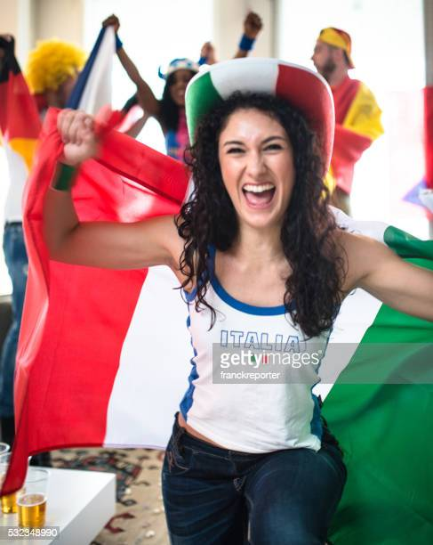 italian supporter woman at home looking the tv