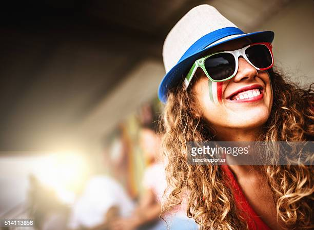 italian supporter woman at the stadium - fan enthusiast stock pictures, royalty-free photos & images