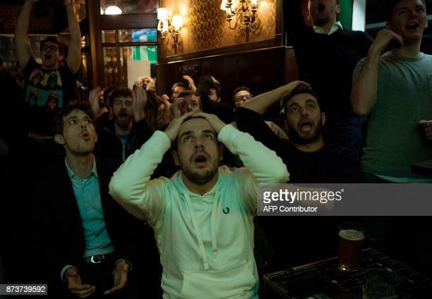 Italian supporters react as they watch in a bar the FIFA World Cup 2018 qualification football match between Italy and Sweden on November 13 2017 in...
