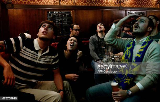 Italian supporters react as they watch the FIFA World Cup 2018 qualification football match between Italy and Sweden on a giant screen on November 13...