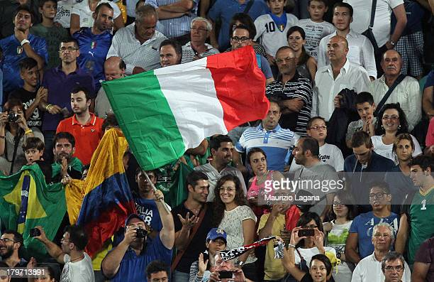 Italian supporters wave their national flag during the FIFA 2014 World Cup Qualifier group B match between Italy and Bulgaria at Renzo Barbera...