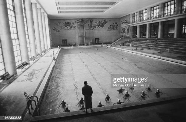 Italian swimmers practicing for an Olympic selection at the Piscina dei Mosaici venue of the 1960 Summer Olympics located within the Foro Italico...
