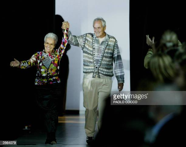 Italian Tai and Rosita Missoni acknowledge applause on the catwalk at the end of the Missoni collection during the last day of the Milan 2004...