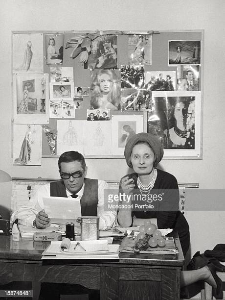 Italian tailor and fashion designer Biki posing with her soninlaw French fashion designer Alain Reynaud in their office in Milan 1960s